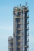 pic of fraction  - Fractionating columns of the oil refinery on the sky background - JPG