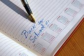 stock photo of scribes  - Open diary with one fountain pen that write BACK TO SCHOOL - JPG