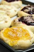 picture of fill  - Raspberry Orange and Cream Cheese filled Kolache pastries. ** Note: Shallow depth of field - JPG