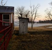 stock photo of outhouses  - This is the way to the outhouse on a foggy country morning - JPG