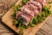 stock photo of charcuterie  - Raw pork ribs on a cutting board - JPG