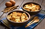 image of dice  - Two rustic bowls of bread pudding made of diced stale bread milk egg cinnamon sugar and butter photographed with natural light  - JPG