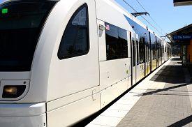 stock photo of passenger train  - Electric passenger train at a city mass transit station in Oregon - JPG