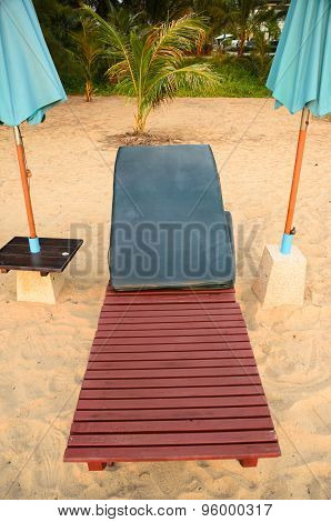 Chair on the sand beach of Thailand
