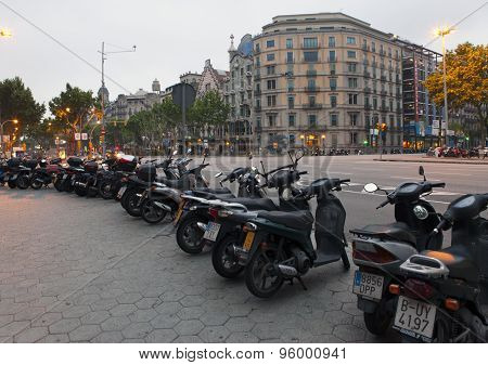 BARCELONA SPAIN - 9 MAY 2010: Motorcycles parked on the city street 9 May 2010 in Barcelona Spain