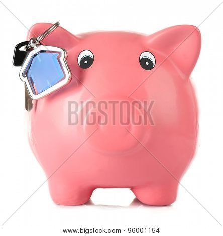 Piggy bank with key isolated on white