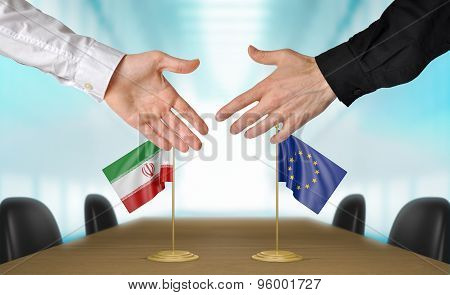 Iran and European Union diplomats agreeing on a deal