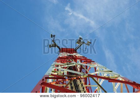 Telecommunication Tower With Antennas And Blue Sky Background