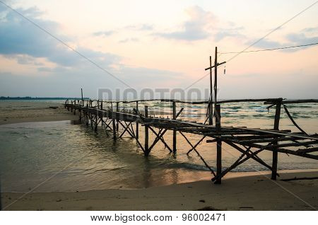 Wood Bridge At Sea And Sunset