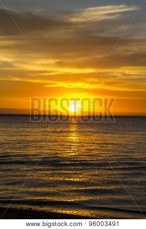 Colorful Tropical Sunset Over A Calm Ocean