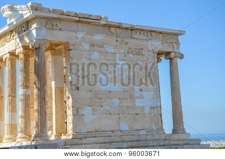 Antique Temple On The Acropolis Site In Athens, Greece.