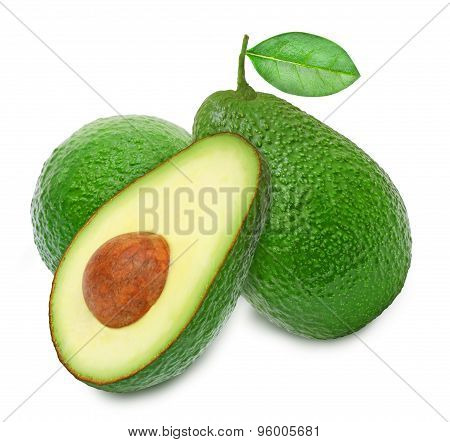 Two fresh green ripe avocado and slice