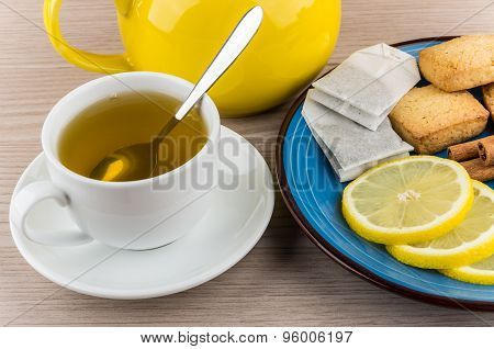 Tea And Plate With Slices Of Lemon, Cinnamon And Biscuits