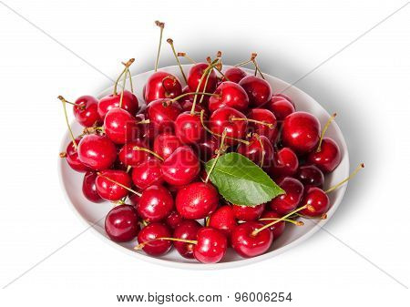 On Top Sweet Cherries With Leaf On White Plate