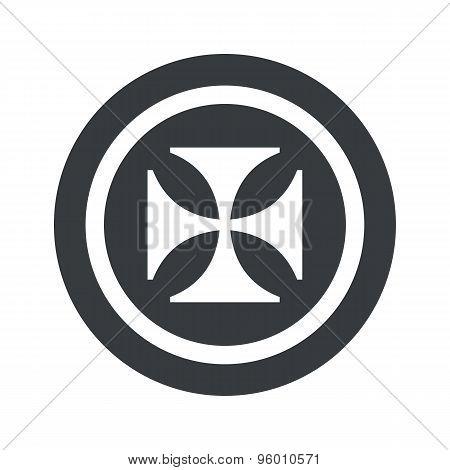 Round black maltese cross sign