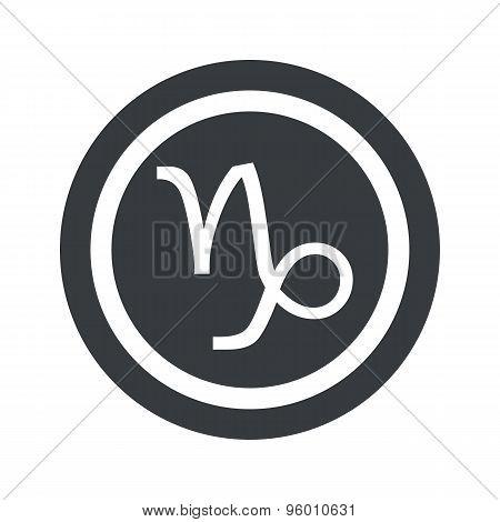 Round black Capricorn sign