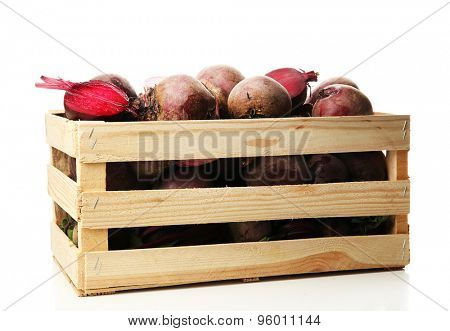 Wooden crate of beets isolated on white
