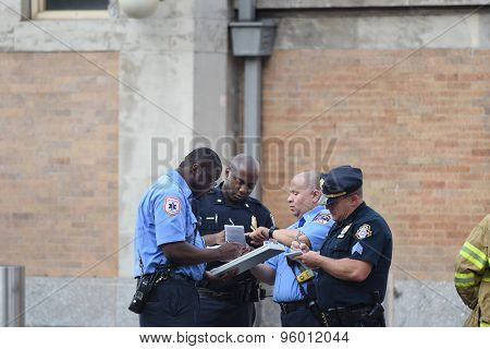 NYPD investigators compare notes