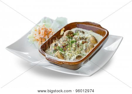 baked mushrooms with cream sauce on a white background