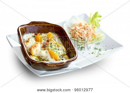 Baked chicken on peaches with vegetables