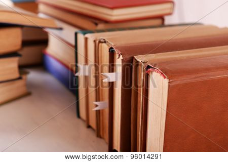 Stacks of books on table close up