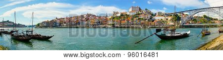 Porto old town skyline on the Douro River with rabelo boats
