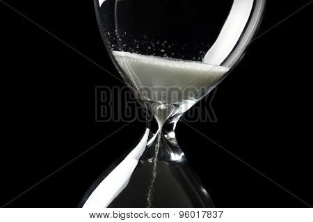 Hourglass on dark background