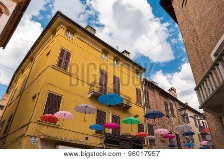 Ancient Medieval Street In The Downtown Of Ferrara City With Umbrellas