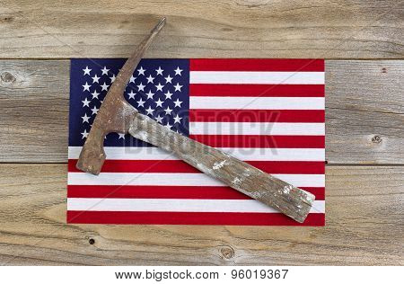 United States Of America Flag And Old Hammer On Rustic Wooden Boards