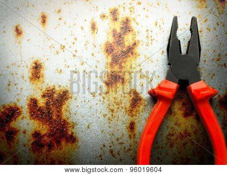 Pliers On Rusty Background