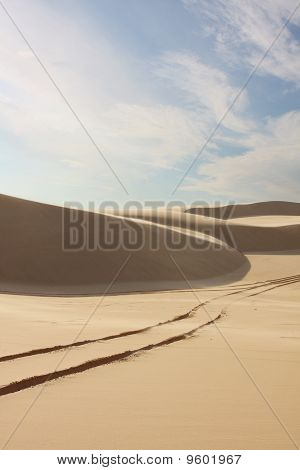 Sand Dunes With Tyre Tracks