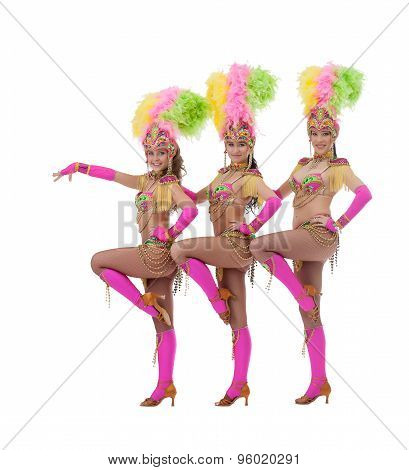 Sexy female dancers dressed in carnival costumes