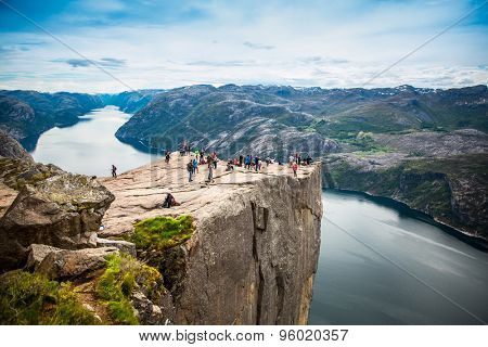 NORWAY- June 22, 2015: Preikestolen or Prekestolen, also known by the English translations of Preacher's Pulpit or Pulpit Rock, is a famous tourist attraction in Forsand, Ryfylke, Norway