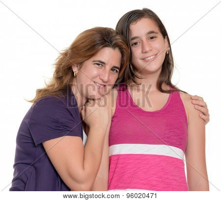 Hispanic mother hugs her teenage daughter isolated on a white background