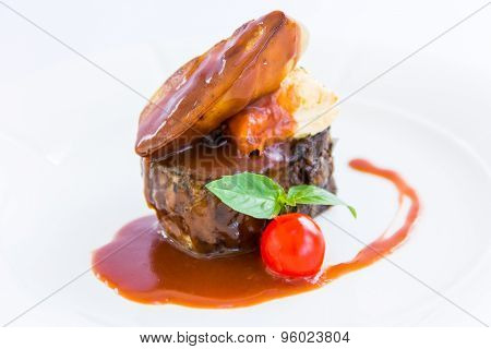 Beef Liver On A Plate On A White Background