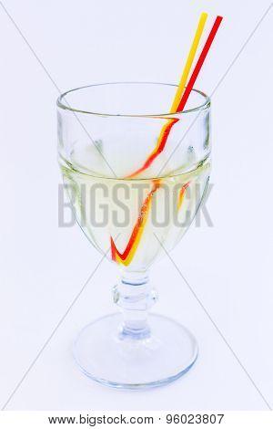 In A Glass Of Lemonade On White