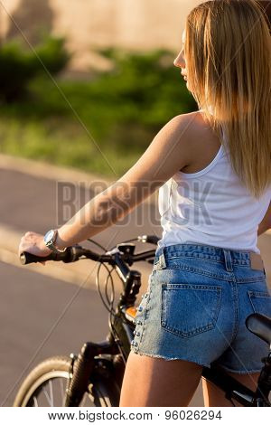 Attractive Young Woman With Bike