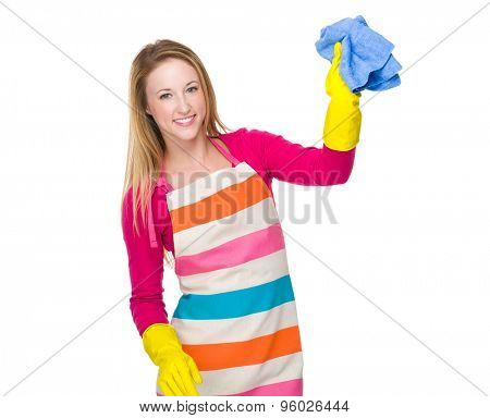 Housewife cleaning with plastic gloves and rag