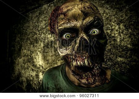 Close-up portrait of a horrible scary zombie man. Horror. Halloween.