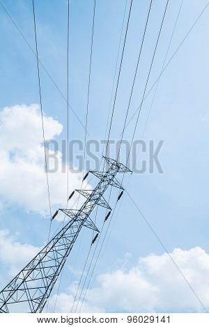 High voltage pole and sky background