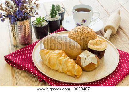 Various Bun And Bread On Wood Table