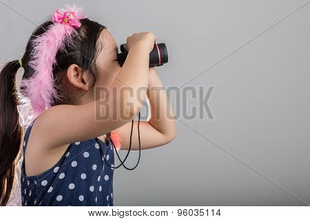Child With Binoculars Background / Girl Looking Through Binoculars Background