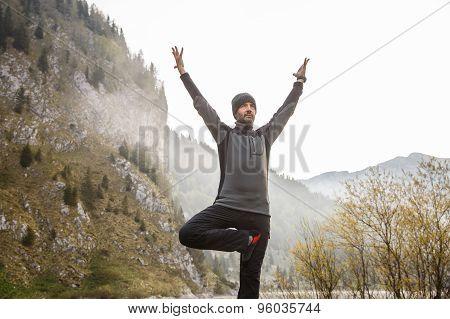 Man Practicing Yoga, Performing A Tree Pose