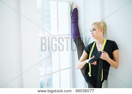 Rhythmic gymnast in the studio