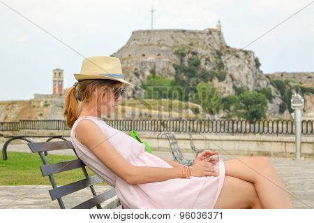 Lady On The Bench With An Old Fortress In Background