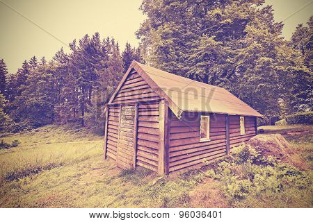 Vintage Filtered Wooden Hut In Forest.