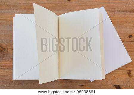 Blank catalog, magazines,book mock up on wood background ( moving page )