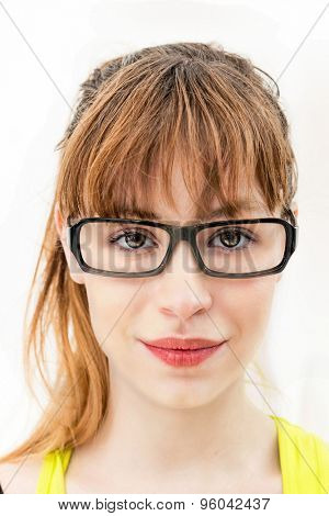 Close-up of a woman holding glasses against white background