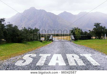 Start word as motivation writen on asphalt road