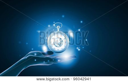 Close up of businessman hand holding pocket watch in hand